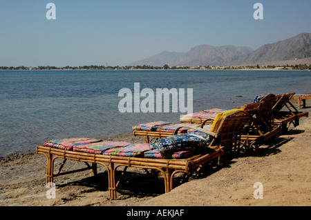 Empty sun loungers in Nuweiba Tarabin beach in Nuweiba also spelled: Nueiba a coastal town in the eastern part of - Stock Photo