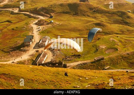 Paraglider landing at Marhi in the Kullu Valley, Himachal Pradesh India - Stock Photo