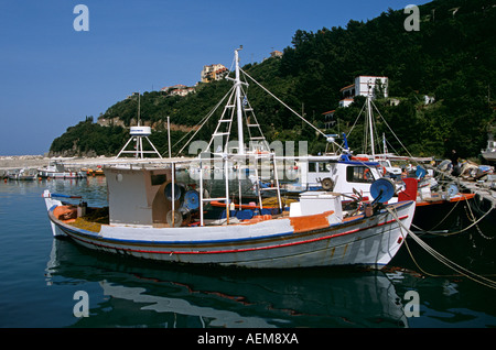 Old white fishing boat moored in Poros harbour, Poros, Kefalonia, Greece - Stock Photo
