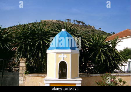 Shrine and Saint George's Castle behind, Peratata, Kefalonia, Greece - Stock Photo