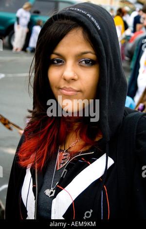 Portrait of attractive Chicana parade participant age 15. Cinco de Mayo Fiesta. 'St Paul' Minnesota USA - Stock Photo