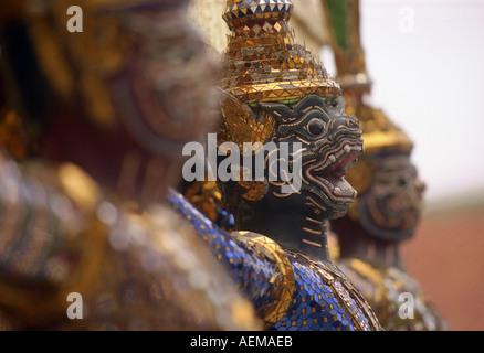 statues at the grand palace in bangkok thailand - Stock Photo