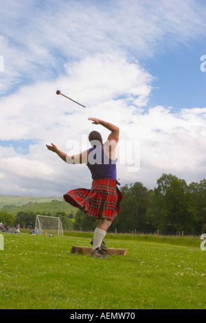Peter Whitehead _ Throwing Event at Scottish Highland games, Braemar throwing hammer. - Stock Photo