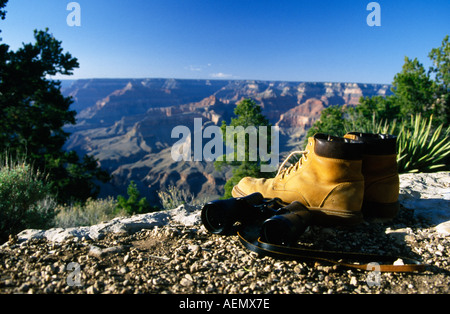 hiking boots with binocular at the edge of grand canyon south rim arizona usa - Stock Photo