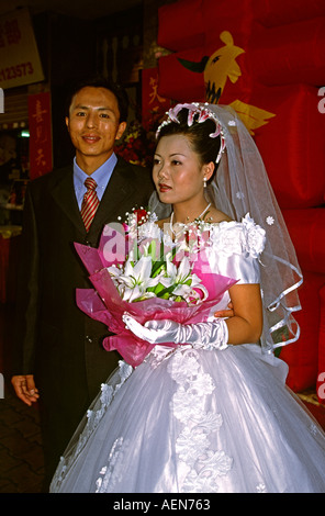 China Yunnan Jinghong newly married couple bride in western style wedding dress - Stock Photo