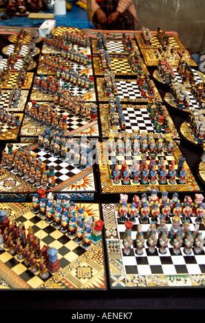 Colourful unusual chess sets on stall, Pisac Market, Pisac, near Cusco, Peru - Stock Photo