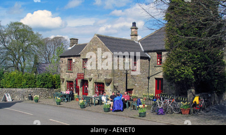 Group of friends having a tea break during bike riding the High Peak Trail, Peak District, Derbyshire, Great Britain - Stock Photo