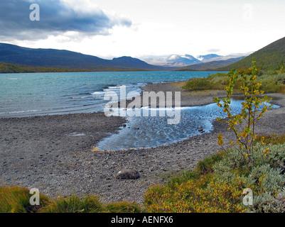 Lake on valdresflya during turning of the seasons / Indian summer, Valdresflya, Jotunheimen, Norway - Stock Photo