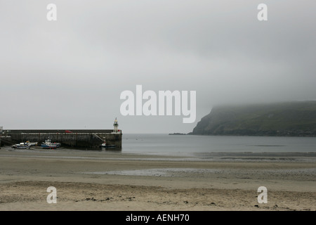 Port Erin beach and pier looking towards Bradda Head in bad weather IOM - Stock Photo
