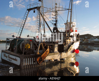 Fishing boats unloading fish on quay in the Harbour of Twillingate, Newfoundland, Atlantic Canada - Stock Photo