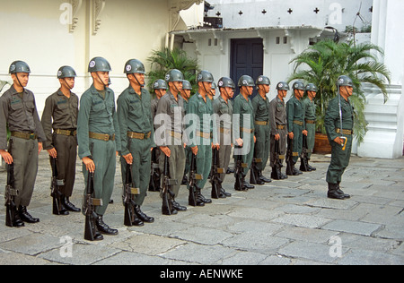 Soldiers standing to attention during changing of the guard, Grand Palace, Bangkok, Thailand - Stock Photo