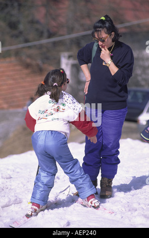 A young girl learns to ski at Les Arcs, Savoie, France. - Stock Photo