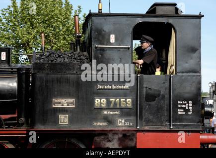 cab of small german steam locomotive - Stock Photo