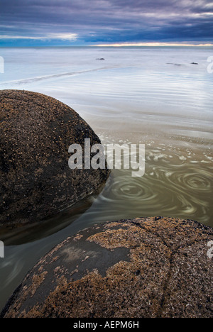 The unusual circular Moeraki boulders along the Otago Coast, New Zealand - Stock Photo