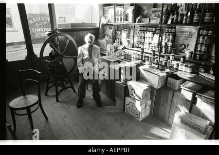 Old man prepares to close his general store in Saltash Cornwall  for the last time after new supermarkets took all - Stock Photo