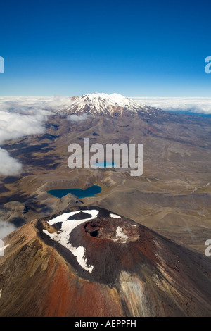 Crater and secondary cone of Mount Ngauruhoe and Mount Ruapehu from the air, Tongariro National Park, New Zealand - Stock Photo
