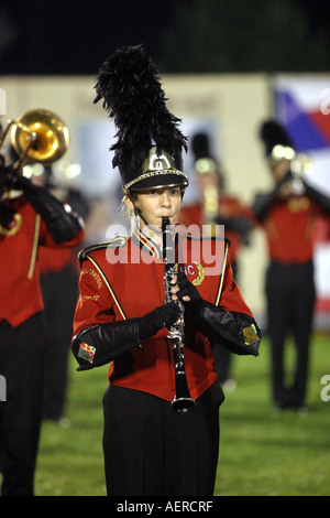 A member of the Hunterdon Central Regional High School in New Jersey plays her clarinet to cheering spectators. - Stock Photo