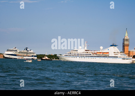 Cruise ships arriving in the Canale della Giudecca and passing San Georgio Maggiore church Venice Italy - Stock Photo