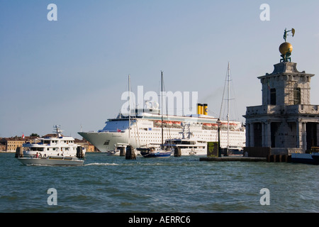 Costa Classica cruise liner arriving in the Canale della Giudecca passes Customs House Venice Italy - Stock Photo