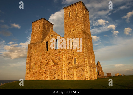 late afternoon sunlight illuminates the remains of Reculver Church on Kent Coastline - Stock Photo