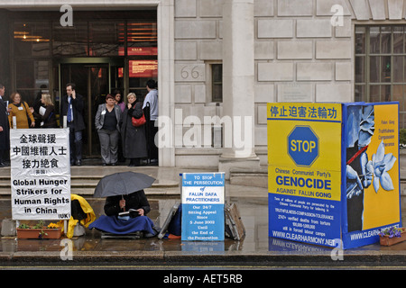 A protester outside the Chinese embassy in London, UK - Stock Photo
