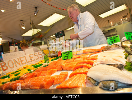 Indoor market stall selling fresh fish England UK - Stock Photo