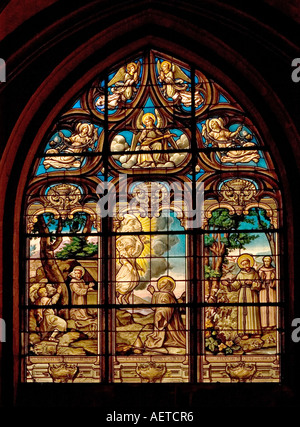 Paris, France. Church of St Medard on Rue Mouffetard. Stained Glass Window showing Saints Bruno, Benoit and Francis - Stock Photo