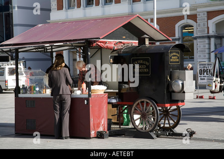CHRISTCHURCH SOUTH ISLAND NEW ZEALAND May Young lady waiting for a baked potato to be prepared - Stock Photo