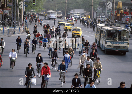 Beijing China Dongsi Bei Street traffic bicycle society public bus taxi cabs - Stock Photo