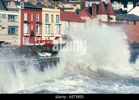 Waves pounding sea wall and rail track in storm Dawlish Devon England United Kingdom Europe - Stock Photo