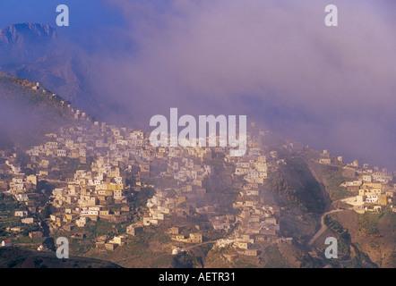 Cloud over Olymbos Olimbos village Karpathos Dodecanese islands Greece Mediterranean Europe - Stock Photo
