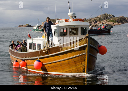 Staffa tourist boat returning from wildlife watching trip Isle of Mull Scotland UK - Stock Photo