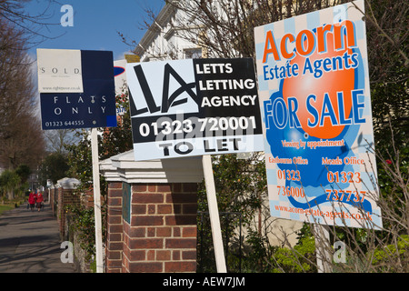Estate Agents 'for sale' and let signs Eastbourne 'East Sussex' England - Stock Photo