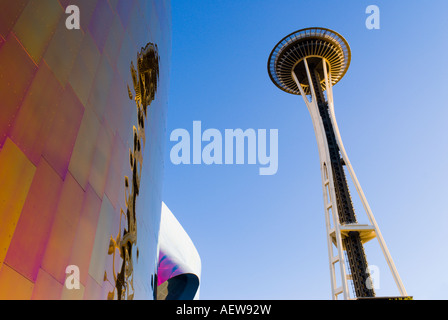 The Space Needle and metal sculpture at the Experience Music Project Seattle Washington - Stock Photo