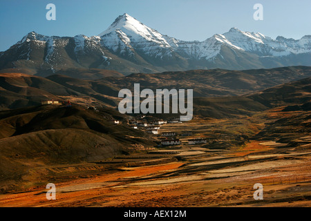 View of village Langza and snow-clad mountains at the backdrop in Spiti Valley, Kaza Himachal Pradesh India - Stock Photo