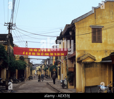Early morning street scene with traditional old buildings in Tran Phu Street, Hoi An, Viet Nam - Stock Photo