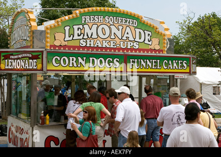 Street festival food and drink refreshment stand booth with customers lined queued up waiting for service - Stock Photo