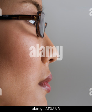 Profile view of woman wearing glasses - Stock Photo