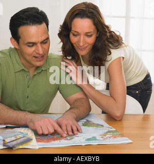 Couple planning a trip - Stock Photo