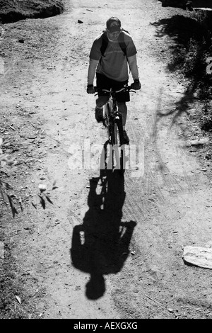 Mountain Bikers cycling on the narrow path during the MTB training session at Parveti valley in Kullu District, - Stock Photo