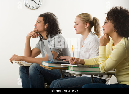 Three college students in class - Stock Photo