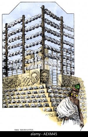 Aztec Tzompantli exhibiting skulls of human sacrifice victims in Tenochtitlan. Hand-colored woodcut - Stock Photo