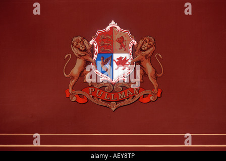 British Pullman crest on side of umber and cream liveried Orient Express railway carriage - Stock Photo