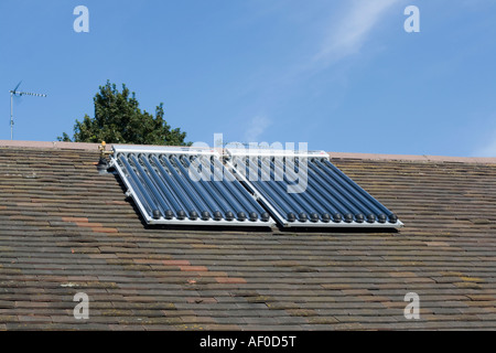 Solar thermal panels with evacuated tubes on roof of Worcestershire House providing domestic hot water UK - Stock Photo