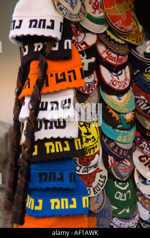 Israel Jerusalem close up of a pile of knitted and colourful skullcaps for sale in the street - Stock Photo
