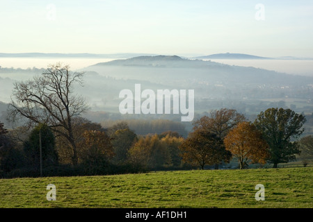 Robinswood Hill and May Hill appearing above the autumn mist in the Severn Vale viewed from Prinknash, Gloucestershire - Stock Photo