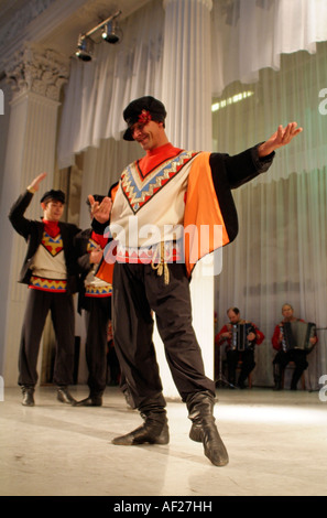Russian folk dancers entertain in traditional costume St Petersburg - Stock Photo