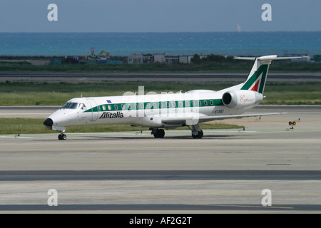 Regional jet Alitalia Express Embraer at Nice Cote d'Azur Airport France - Stock Photo