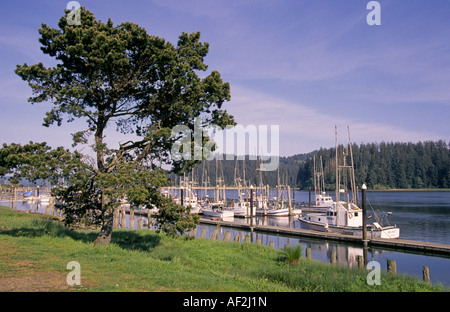 A view of salmon and crab boats in the Florence Harbor on the Oregon coast - Stock Photo