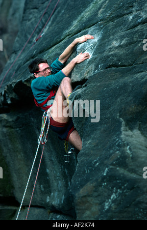 PICTURE CREDIT DOUG BLANE Dave Felce rock climbing in Derbyshire Peak District National Park Great Britain - Stock Photo